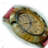 Laikrodzio gintarinis korpusas