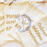 Lininiai maišeliai krikštynoms